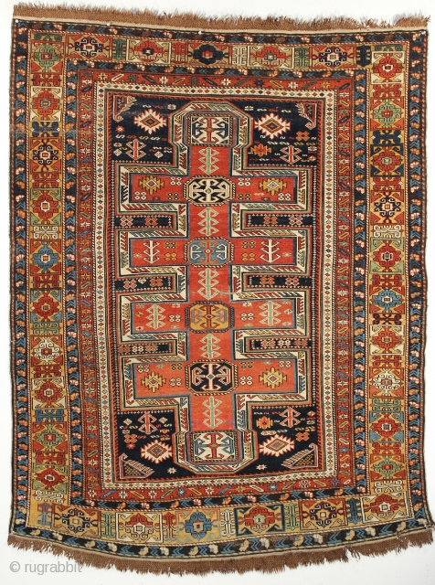 A Shirvan shield designed rug from South Caucasus, circa 1880. 4-3 x 5-5 ft. Complete original braided fringes and sides.