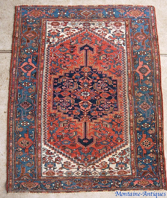 Hamadan-- 4 ft 4 by 6 ft 6 inches. Classic pole medallion; turtle border; Great crisp natural colors. Low but very even with no foundation exposed anywhere.