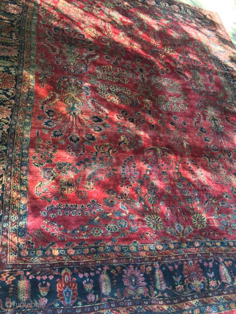 """1920's Persian Sarouk measuring 10'8""""x 13'3"""" in great condition, full pile, one end requires overcasting, some binding is starting to curl.  Thanks!"""