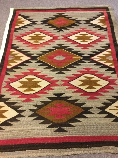"Nice older 1920's  Navajo with an 'A' side and a 'B' side measuring 56""x 71"" ( couple inches wider from one end to the next), few stains, otherwise in good condition."