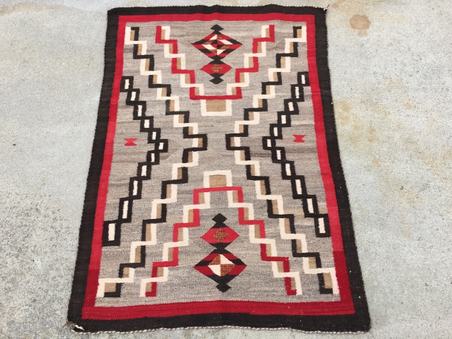 "As found: A nice vintage mid century Navajo rug measuring 3'2"" wide at one end, and 3'4"" at the other end, and 4'8"" long.  In pretty good shape except for a  ..."