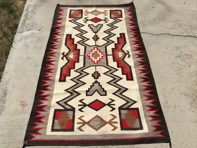 """Aside from the little bit of the red color fading on one side, this 1930's JB Moore Storm Pattern Crystal Vintage Navajo Rug measuring 3'7""""X 6'2"""" is good to go.  Woven  ..."""