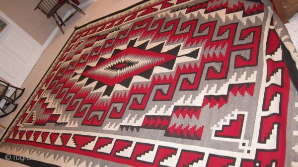 1940's to 1950's mint condition Navajo rug measuring 9'x 12'.