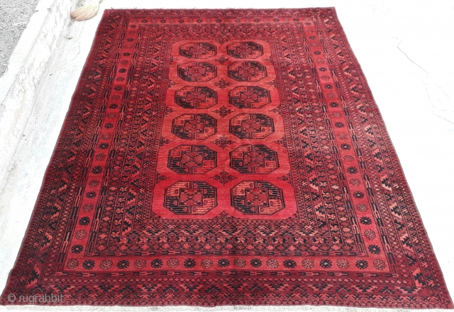 Very old Turkmen elephant feet rug will vegetable dyes and karakol wool. Excellent condition. size 295x225 cm