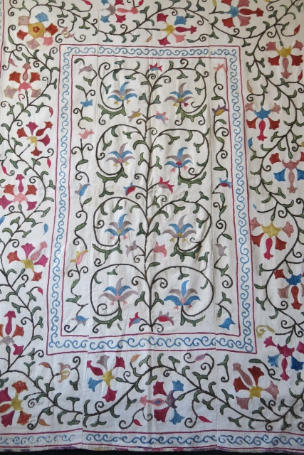 Uzbekistan Lakai suzani - silk Chain sticth on hand-loomed cotton - kharboz. Traditional Islimi motifs.Adras ikat facing with printed backing. Couple tiny light red runs - can be seen on close up  ...