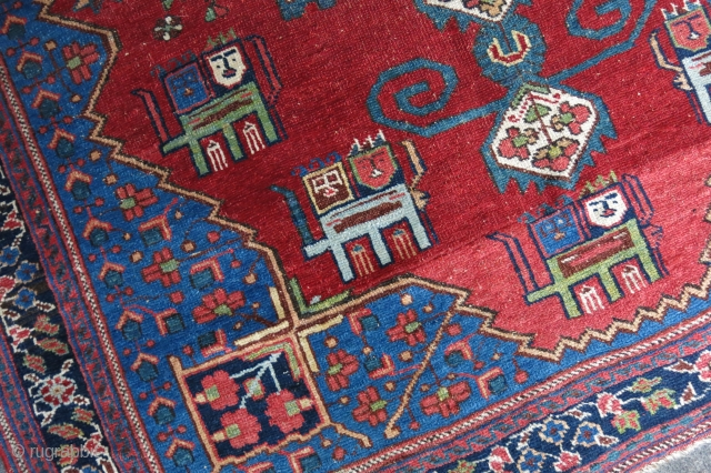 "Afshar tribal rug with national Lion figures in the field. Great saturated natural colors. Small area old wool repairs on the red field.  55"" X 48"" -  140 cm X  ..."