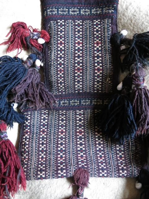 "Afghanistan - Baluch tribal salt bag. Both side fine weave with great saturated colors and long large traditional Baluch shelled tassels. Circa 1900 or earlier. Size : 18 1/2"" X 12"" -47  ..."