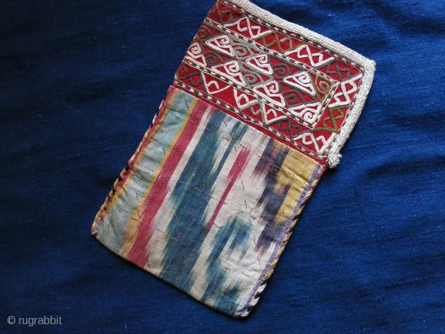 """Turkmen Chodor small bag for valuables. Chain stitch emrboidery neck with Ikat body.Lined with printed cotton. Circa 1920 -30s. Size : 9"""" X 5.1/2"""""""