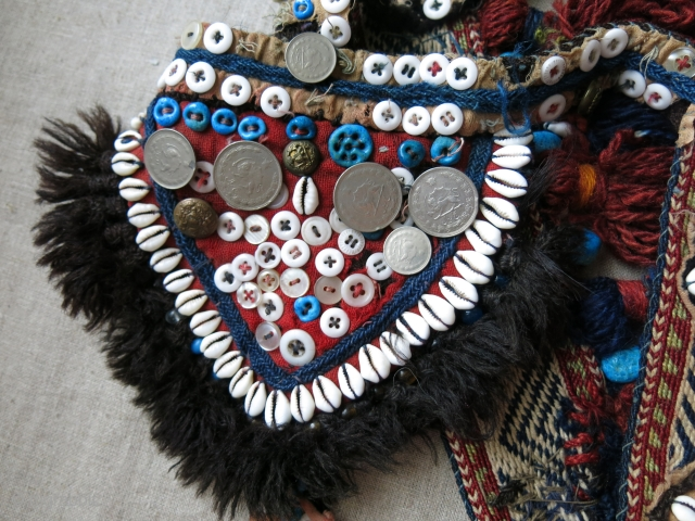 Southwest of Persia- Qashkai animal trapping- head wear. Cowry shells, buttons and other ornaments with tassels with an old Qashkai strap.