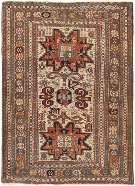 Perpedil Rug, Antique Caucasian Rug, Circa 1900 - Lesghi stars with stepped outlines and arrow-like appendages flank a central medallion featuring Perpedil's famous ram's horns along with geometric symbols and elibelinde motifs  ...