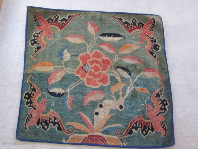 Tibetan mat with four gaily colored bats and a central lotus on an unusual and attractive green ground c.1920-30