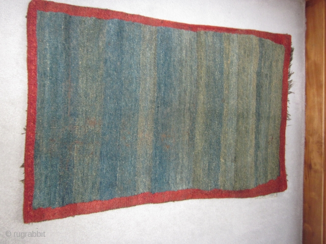 Tibetan, small khaden, attractive abrashed indigo ground, good red, before 1900