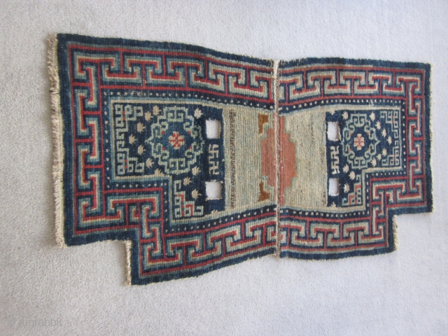 "Tibetan : Vintage notched saddle bottom rug, 2"" by 3'8"", before 1900. Some re-piling around one cinch strap."