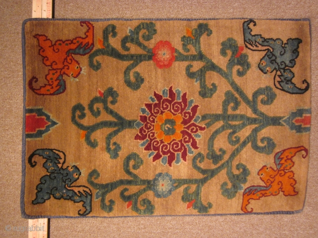 Tibetan mat with tree of life image. The bats at all 4 corners are poised and ready to extract nectar from the flowers. Good color, graphic images, and great condition. c.1920.