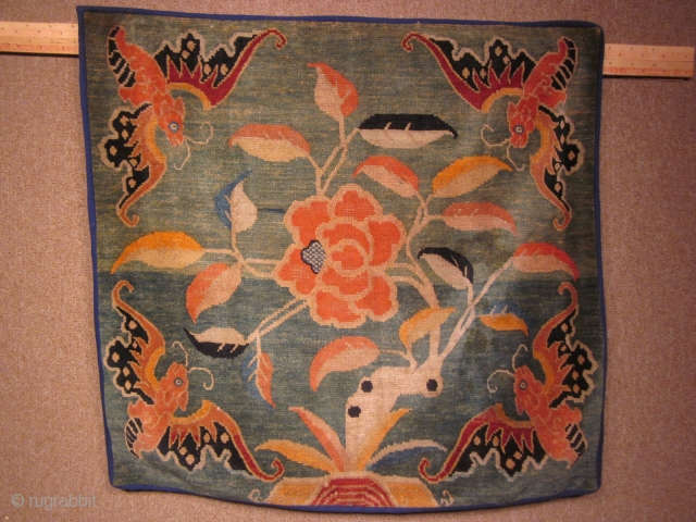 Tibetan mat. Bats with lotus on soft green ground. c.1920