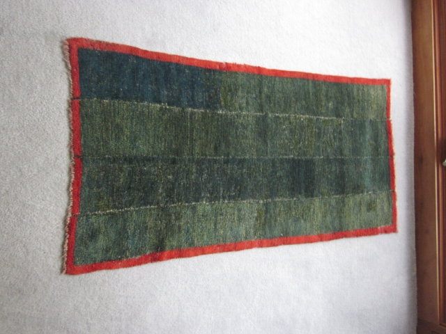 Tibetan tsuk truk, four panel bedding rug in green with red border. $450