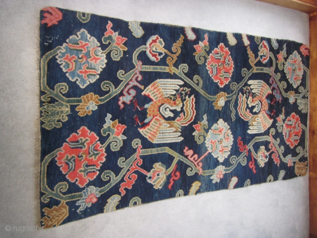 """Tibetan khaden, floral elements, including lotuses, and two phoenixes (that look like peacocks!) on indigo ground, c.1930, 2'11"""" by 5'6"""" $700"""