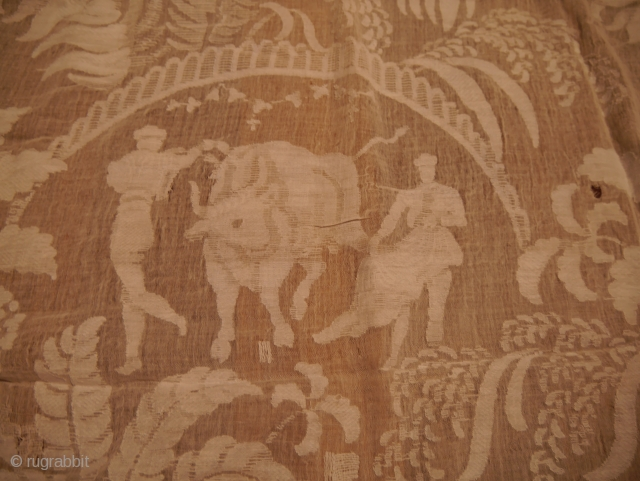 Olé! A VERY rare beginning of 20th Century curtain with bull fighting motifs from Navarra, Spain.  Extremely fine cotton, some tears in places. It comes from a very large and wealthy  ...