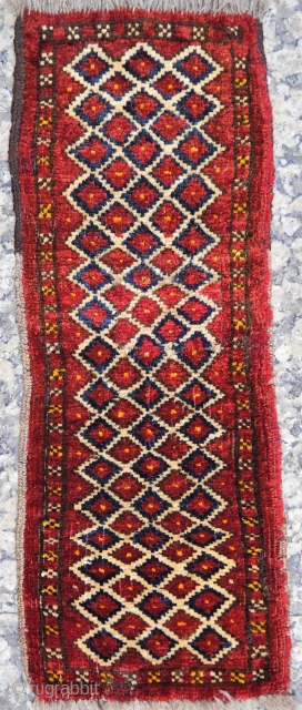 A Kunduz area, North East Afghanistan,  cute little rug made by a young girl to learn the art of weaving. Glossy wool, with nice touches of yellow colour. 60x22 cms. (A1812031)
