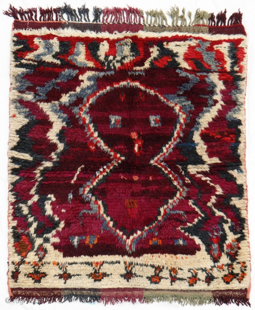 This Persian gabbeh has the most peculiar design that we have probably seen since we began our journey in the world of rugs in 1997. A figure that could be a bird,  ...