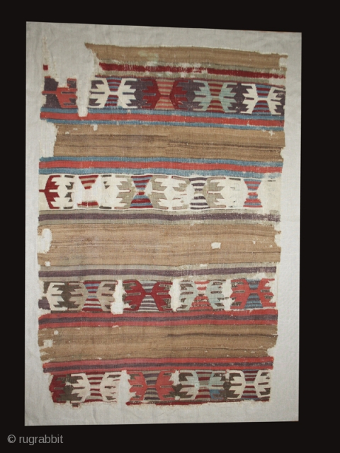 Kilim fragment cod. 0666. Central Anatolia. Early 19th. century or before. Cm. 97 x 145 (38 x 57 inches). Mounted on linen.