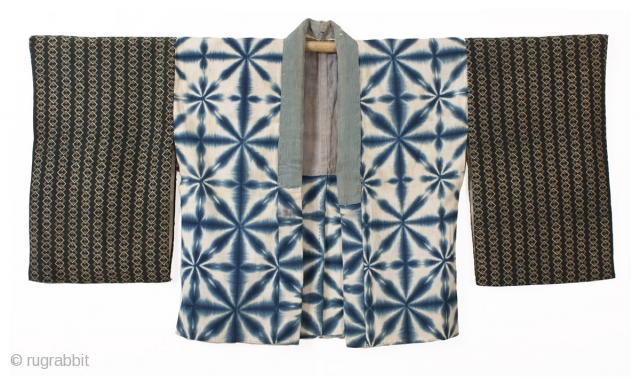 This is a striking shibori dyed han juban, which is often worn underneath a kimono. Shibori is a Japanese dying technique where patterns are made by binding, stiching, folding, twisting, and compressing  ...