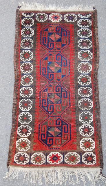 Baluch tribal rug. Circa 1900. 129 x 68cm. Good colour and condition.