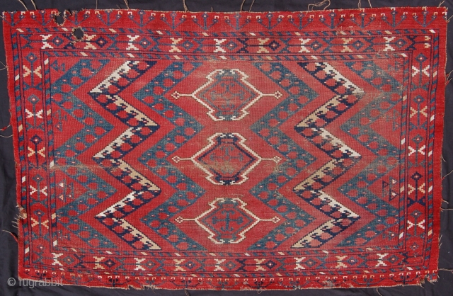 Antique Ersari chuval with cotton pile. 140 x 92cm. Organic dyes. Wear and some holes but a good example for a fair price.