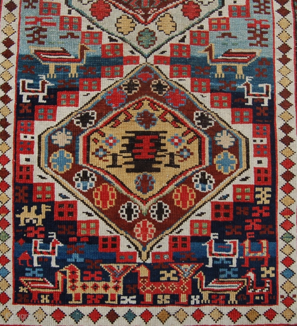 Beautiful small antique Shirvan rug. Circa 1870. a charming and lively rug with rich organic dyes and plenty of animals decorating the field. Some low pile and some minor edge work done.  ...