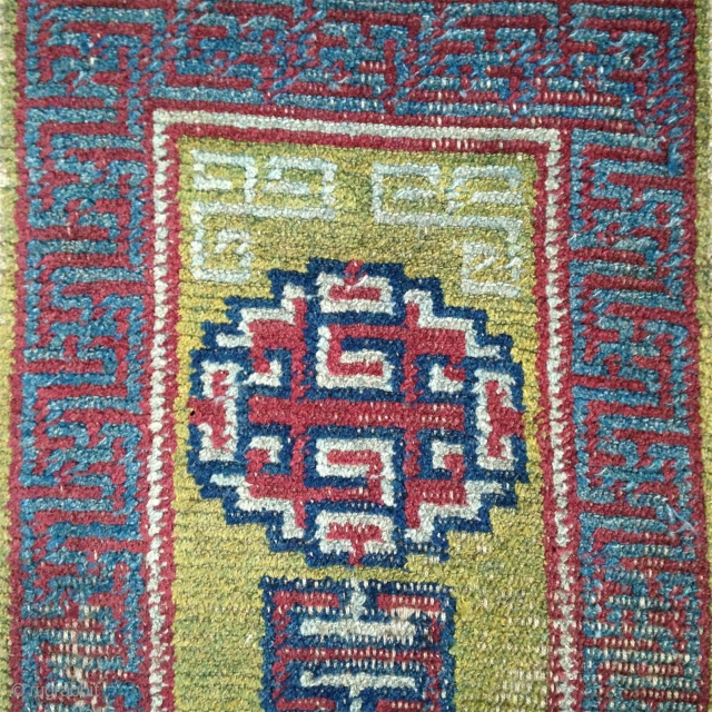 early tibetan saddle rug with beautiful clear old colors. exquisite light green back ground. very fine weave and super soft handle.. mid 19th century