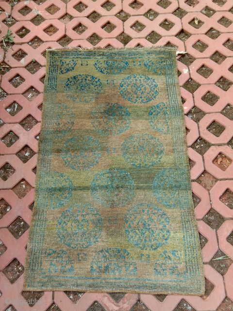 late 19th c tibetan khaden with terrific abrash in turkis blues and greens... top wool good condition with ab area of low pile... a rare beauty
