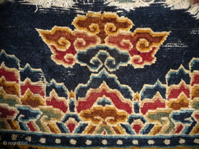 fragment of a rare tibetan saddle rug. it is late 19th century but all colors are natural. the main color is a wonderfull gold yellow. uncommon is its small size, trapezoidal shape  ...