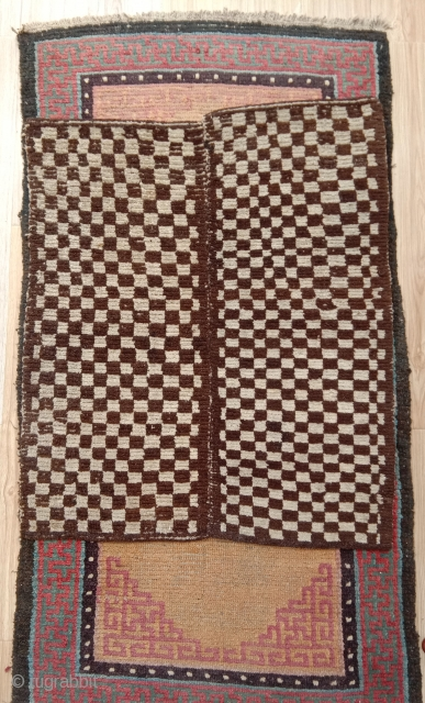 very rare checkerboard mat, truly nomadic piece made in 2 halves on a small narrow loom.. tibet 19th century
