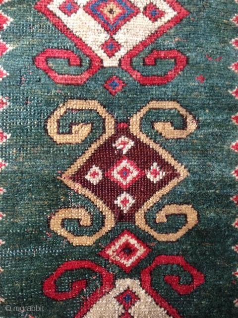 extraordinary caucasian kazak green field rug..
