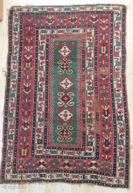 rare early caucasian rug with stunning narrow green field...