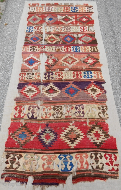 "Early Central Anatolian banded ""one-piece"" kilim. Conserved and mounted on linen. 18th c. or older."