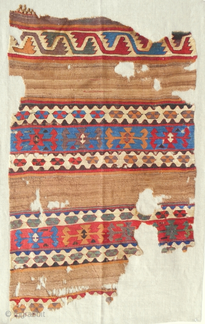 Circa 1800 Anatolian banded kilim panel fragment with true camel. Conserved and mounted on linen.