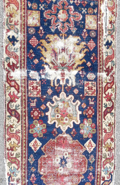 Complete 18th c. Northwest Persian long rug (detail) with dragon border.