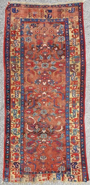 Early 19th c. Kurdish Saujbulagh rug with corroded brown field & Herati design.