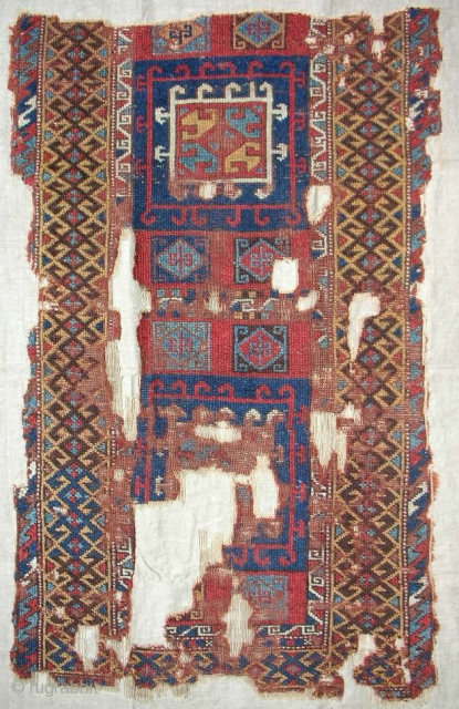 Extremely rare 18th c. East Anatolian Kurdish rug fragment. Sourced in Instanbul. Conserved and mounted on linen.