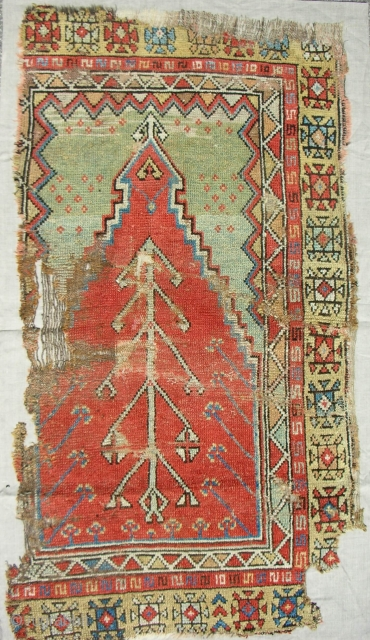 18th c. Konya Prayer rug fragment. Mounted on linen.