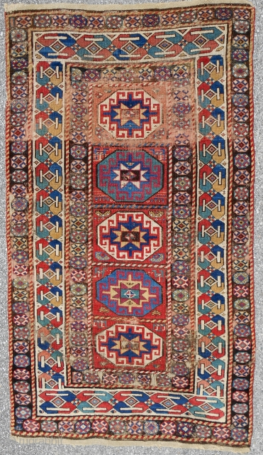 Very attractive South Caucasian Moghan rug with clear, saturated color and corrosive browns. C. 1850-70. Complete and original. Medium, even pile.