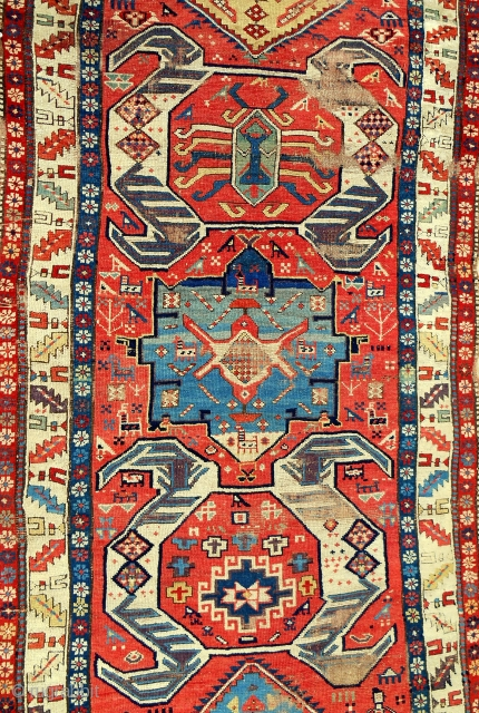 South Caucasian long rug. circa 1840. Clear, saturated color & dramatic design. Mostly fair condition.