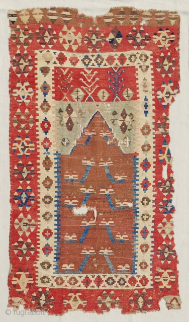 Obruk prayer kilim with excellent color range. Early 19th c. Conserved and mounted on linen. Sublime.