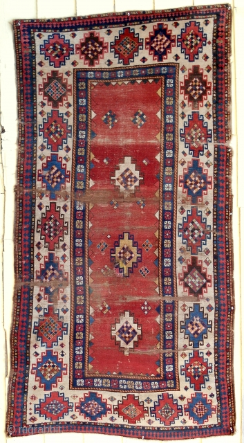 Caucasian Kazak rug > 1850-70 > Rare Memling gul white border. Acceptable condition (for age) with areas of wear and old repairs.