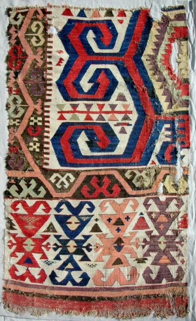 18th c. central Anatolian kilim fragment. Professionally conserved and mounted on linen.