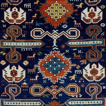 Perepedil rug with unusual symbols/motifs. Note the whie palmettes with double headed birds (?) and the 'exploding'flowers throughout the central spine of the rug. Caucasus, 19th century, perfect condition,  glowing, deep  ...