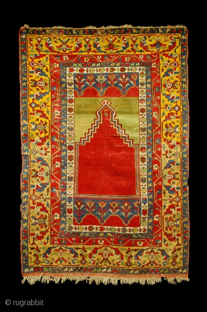 """Tulip"" Ladik prayer rug, Turkey, Konya region, 1850-1880, wool on wool, 200x135 cm, 5 borders (!) made out of wonderful yellows (a pastel one until the middle of the Mihrab and a  ..."