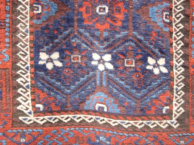 Late 19th century Baluch Mina Khani rug with full pile and kilims, but, with corrosion to browns/black.  Two blues,  aubergine/brown, red, natural white and a couple of yellow flecks in  ...