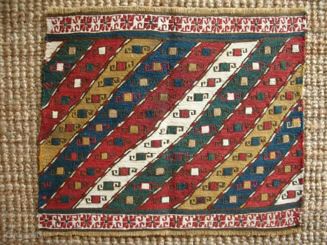 Mafrash end panel, Southern Caucasus, Qarabagh region, 44 x 37cms, wool warps, some silk foundation wefts, cotton extra-weft wrapping in borders and in one diagonal stripe; same design as one of the  ...